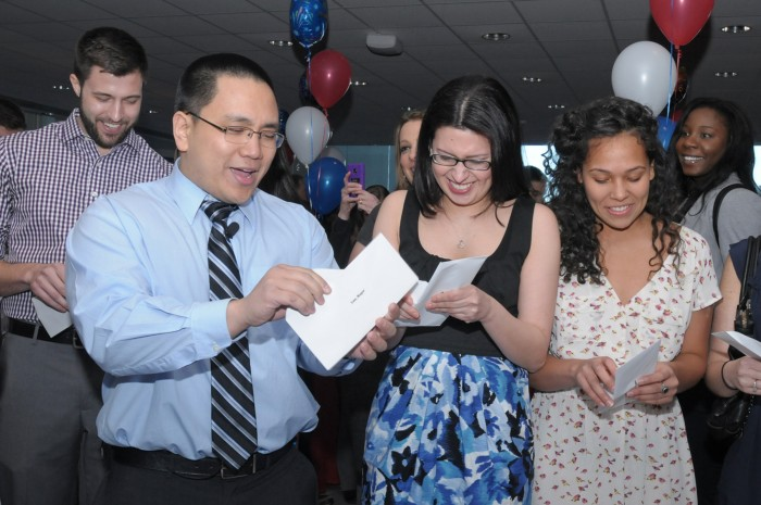 Roger Luo and Gaby Chancay open their envelopes revealing their residency assignments — mere moments before the marriage proposal.