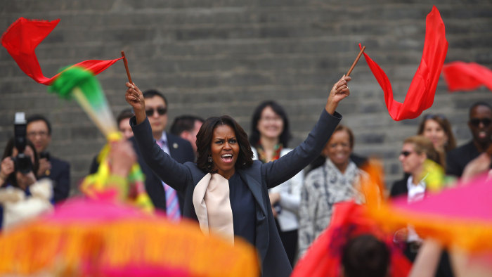 U.S. first lady Michelle Obama (C) dances with folk performers as she visits the City Wall, in Xi'an, Shaanxi province, March 24, 2014. REUTERS/Petar ...