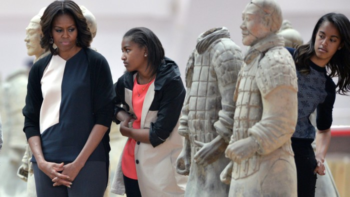 US First Lady Michelle Obama (L) and daughters Sasha (C) and Malia (R) look at the Terracotta Warriors in China's central Shaanxi province of Xian on ...