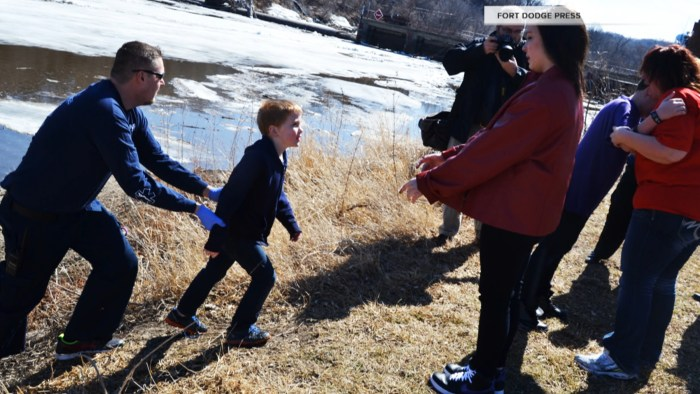 Rescuers reunited the boys with their mother and sister on the banks of the Des Moines River.