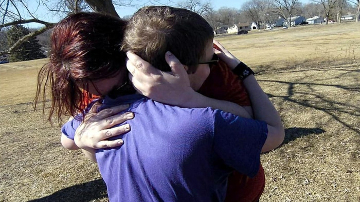 Corbin Crawford and his mother shared a hug after his rescue.