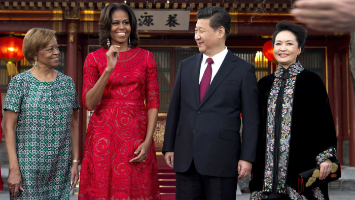 U.S. first lady Michelle Obama, second from left, her mother Marian Robinson, left, share a light moment with Chinese President Xi Jinping, second fro...