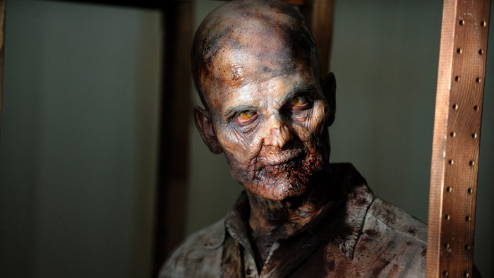 "This undated publicity photo provided by AMC shows a zombie in a scene from AMC's TV show, ""The Walking Dead,"" Season 3, Episode 1. The show airs Sund..."
