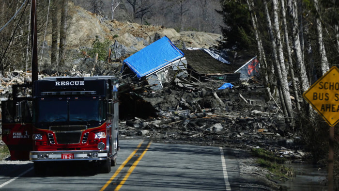 "Searchers are ""dealing with devastation,"" said the county's emergency management director."