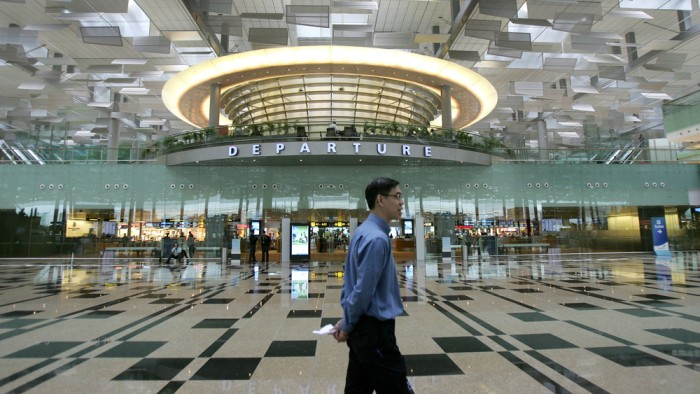 Image: A man walks past the departure gate in Singapore's Changi Airport on Jan. 9, 2008.