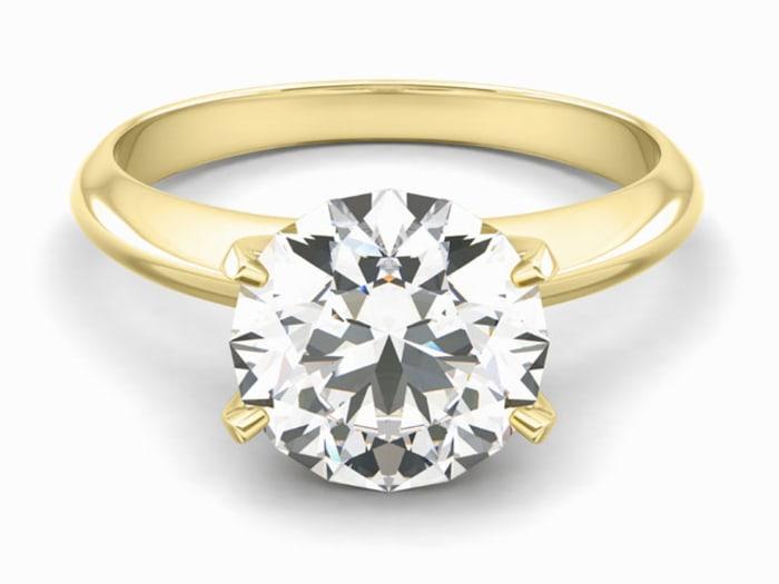 women buying engagement rings