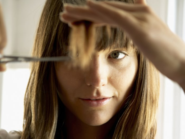 Living on the Fringe: How to Trim Your Bangs Between Salon Appointments