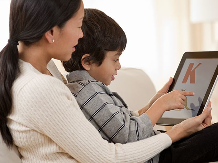 Boy and mom with iPad - Best Learn-to-Read Apps for Kids