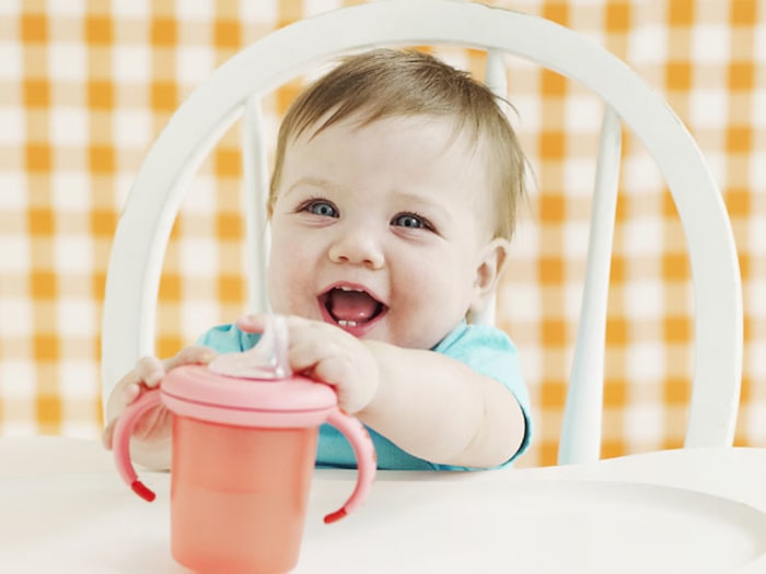 Baby in High Chair -- New Food Allergy Guidelines for Babies and Kids