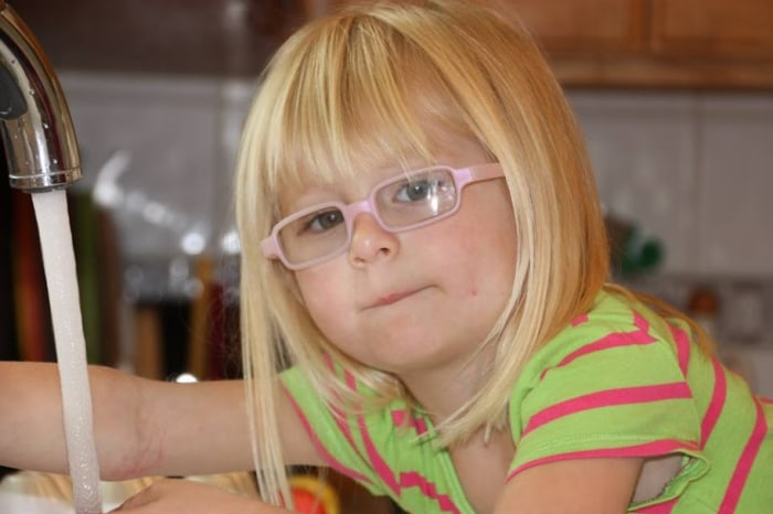 Helen, age 3, has worn glasses since 15 months.