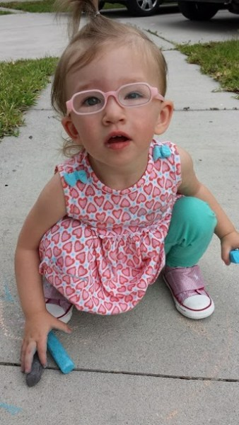 Ella,19 months, is blind in her left eye but it doesn't hold her back one bit.