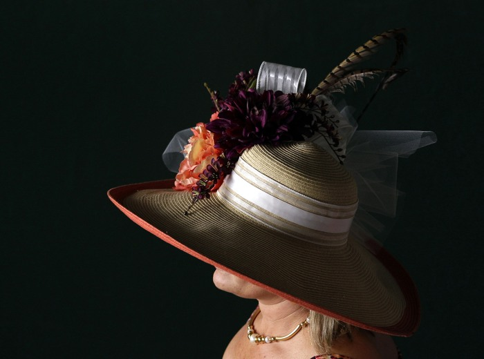 A spectator wears a fancy hat before the 138th Kentucky Derby horse race at Churchill Downs Saturday, May 5, 2012, in Louisville, Ky. (AP Photo/Matt S...