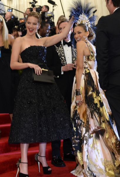 Jennifer Lawrence and Sarah Jessica Parker attends the Costume Institute Benefit at The Metropolitan Museum of Art May 6, 2013, celebrating the opening of Punk: Chaos to Couture.