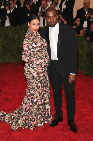 """Kim Kardashian and  Kanye West attend the Costume Institute Gala for the """"PUNK: Chaos to Couture"""" exhibition at the Metropolitan Museum of Art on May 6, 2013 in New York City."""