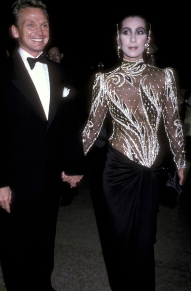 """Designer Bob Mackie and Cher attend The Metropolitan Museum's Costume Institute Gala Exhibition of """"Costumes of Royal India"""" on December 9, 1985."""
