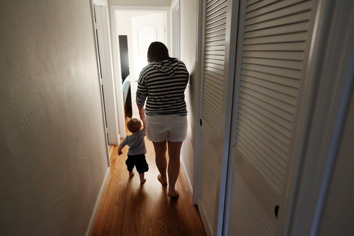 Kelly Hofstra walks with her son, Mason,1, to take a bath at their home in San Diego, Calif. Kelly and her husband, Darren, both work full time and wish they had more time to spend with Mason.