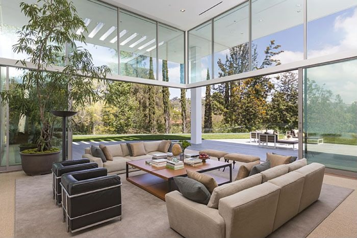 Walls of glass and sliding doors give each space a grand, luxurious feel.