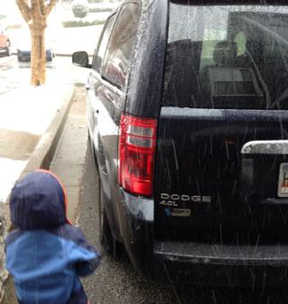 "Sarah Zylstra Meyer  says, ""Here's our 2010 Dodge grand caravan minivan! GA valentine snowstorm  my son had fun ""brushing"" the snow off! We love our v..."