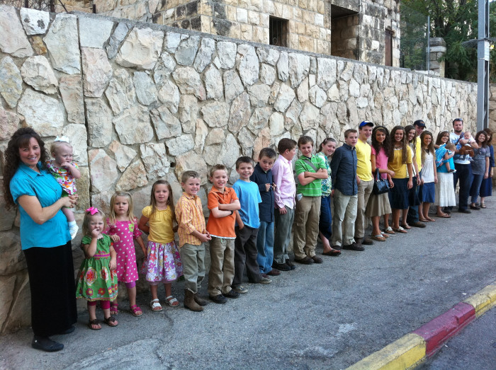 Take time to encourage: Michelle Duggar with her 19 children (and some grandchildren, and daughter-in-law)!
