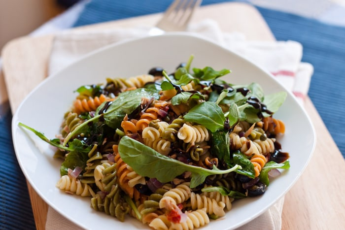 Warm pasta salad with tuna, olives and capers