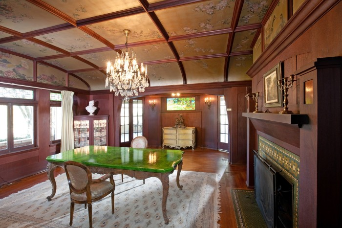 The formal dining room has hand-painted ceilings in gold and silver leaf.