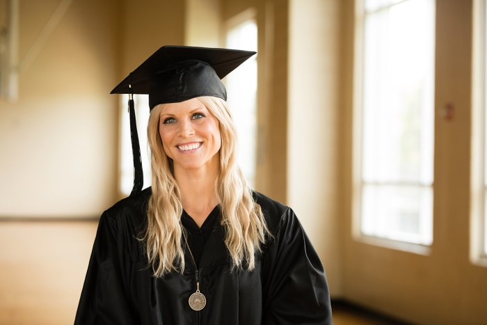 Elin Nordegren, the ex-wife of Tiger Woods, poses after receiving the Outstanding Graduating Senior Award for the Class of 2014 during her May 10 graduation from Rollins College.