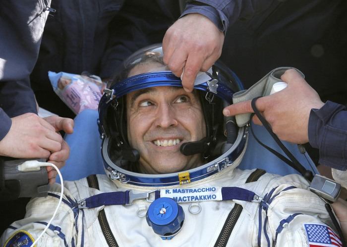 U.S. astronaut Rick Mastracchio is helped by medical staff and technicians shortly after the landing of the Russian Soyuz TMA-11 space capsule, south-...