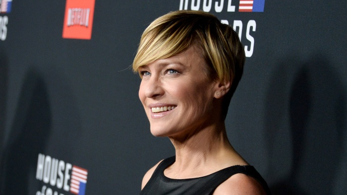"""LOS ANGELES, CA - FEBRUARY 13:  Actress Robin Wright arrives at the special screening of Netflix's """"House of Cards"""" Season 2 at the Directors Guild Of..."""