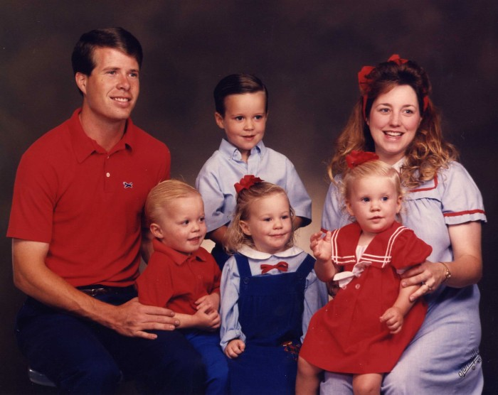 The Duggars in the 1990s with their four oldest children. They decided early on not to use birth control, and 19 children later, they're hoping for more, if possible.