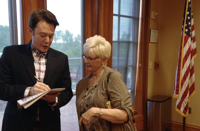 "Democratic nominee Clay Aiken signs an autograph for a constituent after a campaign forum in Cary, North Carolina, April 28, 2014. The ""American Idol""..."