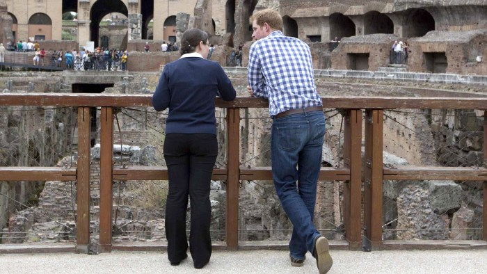 Britain's Prince Harry (R) listens to Italian guide Laura Ciglioni as he tours the Colosseum in Rome May 19, 2014. REUTERS/Alessandra Tarantino/Pool  ...