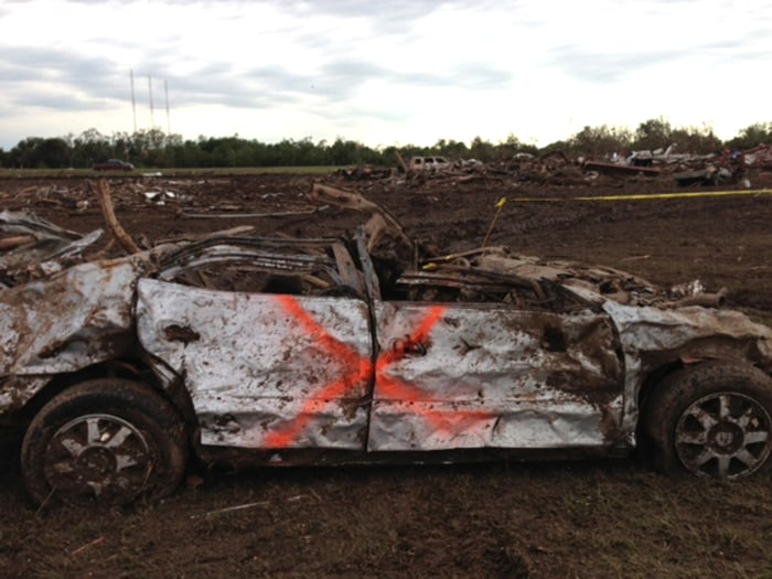"The tornado killed 24 people. The orange ""X"" on this car indicates no bodies were found inside."