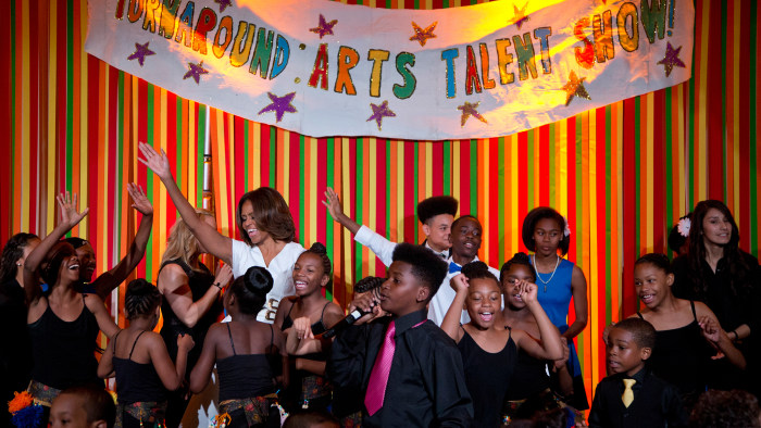First lady Michelle Obama dances on stage with student performers as she and the President's Committee on the Arts and the Humanities (PCAH) host the ...