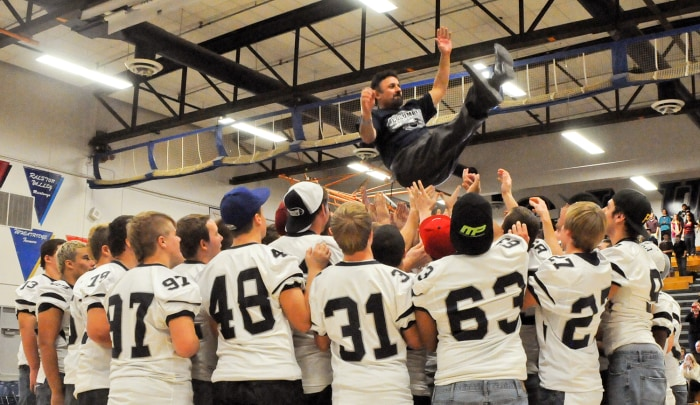 DeAngelis celebrates with his students when Columbine won the 5A state football championship.