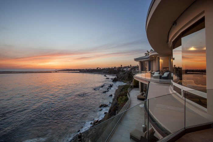 The custom-designed oceanview home features more than 180-degree views out the front wall of glass.