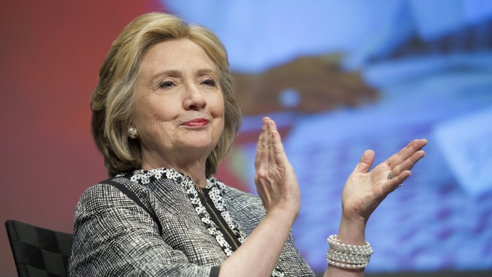 """Former Secretary of State Hillary Rodham Clinton applauds during introductions before addressing the World Bank Group's report """"Voice and Agency: Empo..."""