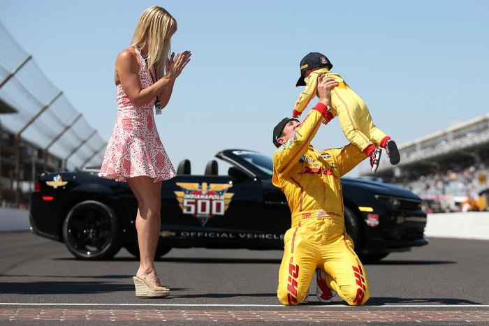 Ryan Hunter-Reay and his wife, Beccy, celebrate with their 1-year-old son, Ryden, who is wearing a miniature version of his father's firesuit, after Hunter-Reay won the 98th running of the Indianapolis 500 on Sunday.