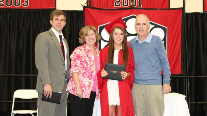 Georgia high school senior Annie Cusack was able to enjoy a happy moment with her father, Brian, who has battled colon cancer in the past year, along with her mother, Kathy, and older brother, Joe. Annie missed her official graduation because of kidney stones, but the school had a special ceremony just for her three days later with more than 50 of her classmates and all her teachers in attendance.