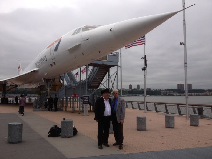 Fred Finn and Tom Stuker stand in front of a British Airways Concorde jet at the Intrepid Sea, Air & Space Museum on Wednesday in New York City.