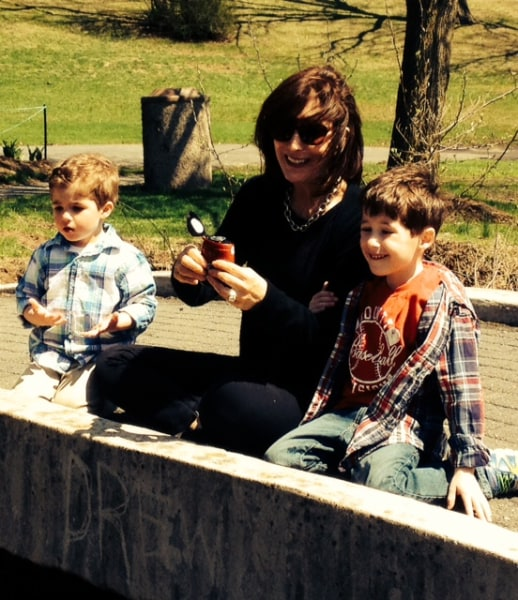 """Roseann Shaiman """"definitely encouraged it"""" when her grandson started calling her RoRo. Here, she and grandsons Jonathan (L) and Daniel (R) blow bubbles on Mother's Day."""
