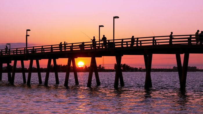 Sunset at the fishing pier,Sarasota Florida; angler; beach; beautiful; beauty; dawn; daybreak; dusk; fishermen; fishing; florida; hobby; lake; landmar...
