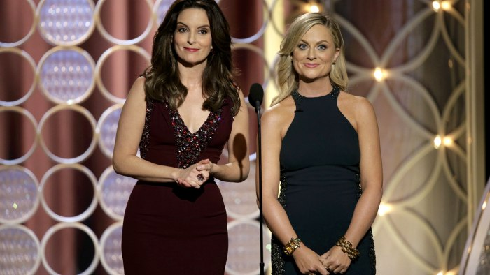 image: Amy Poehler and Tina Fey hosting the 71st annual Golden Globe Awards in Beverly Hills, California January 12, 2014.