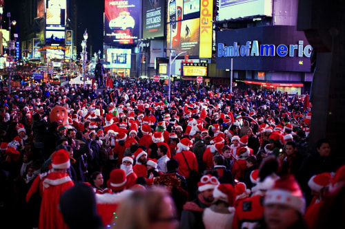 Thousand of people dressed in Santa Claus costume gather at Times Square during the annual SantaCon celebration in New York on Dec. 10, 2011.