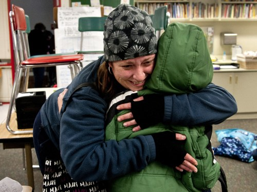 IMAGE: Alicia Combo hugs son after school Friday