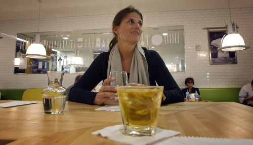Traveler Liz Lamoureux sits in the Food Network Kitchen at the Fort Lauderdale-Hollywood International Airport, in Fort Lauderdale, Fla., sipping a gl...
