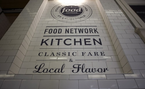The logo for the Food Network Kitchen is seen at the Fort Lauderdale-Hollywood International Airport in Fort Lauderdale, Fla. The airport is the first...
