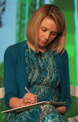 "Marissa Mayer, pictured in May, before her big CEO/baby announcement. Wonder what she's writing? ""Mason.... no, too popular. William.... no, I knew a ..."