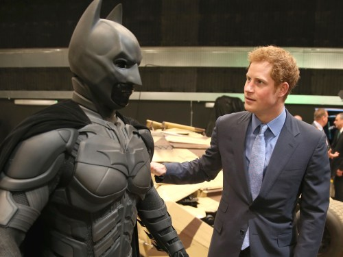 LONDON, ENGLAND - APRIL 26: Prince Harry looks at a 'Batsuit' which was use in the Batman films during the Inauguration Of Warner Bros. Studios Leaves...