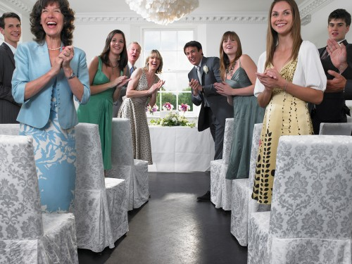 Wedding guests look down the aisle. An American Express has found that wedding guests are spending $539 on average to attend a wedding.