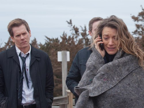 "Ryan Hardy (Kevin Bacon) watches Claire (Natalie Zea) on the season finale of ""The Following."""